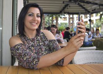 Beautiful Woman is Doing Selfie in cafe