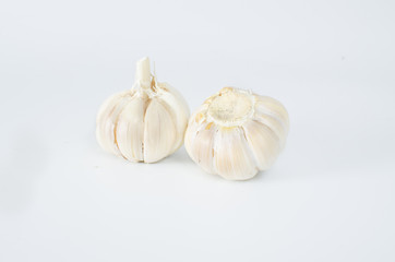 multi bulb garlic in sack on white background