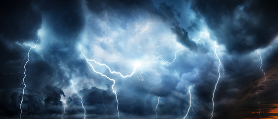 Lightning thunderstorm flash over the night sky. Concept on topic weather, cataclysms (hurricane, Typhoon, tornado, storm) Wall mural