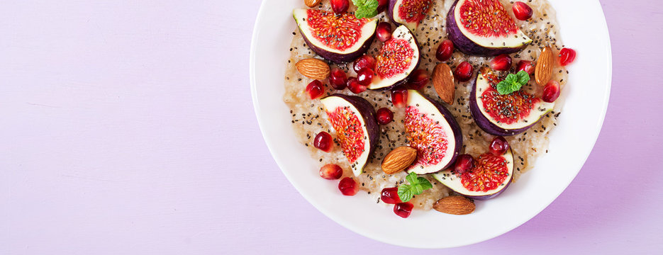 Delicious and healthy oatmeal with figs, almond and chia seeds. Healthy breakfast. Fitness food. Proper nutrition. Flat lay. Top view. Banner