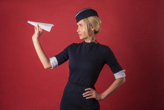 stewardess holding a paper plane