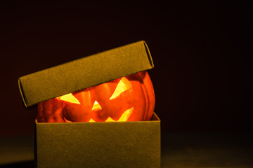Close-up of halloween pumpkin in mysterious craft box