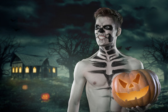 Sport and health food, Halloween gourd. Young man with muscular body and pumpkin. Strong man body. Nude concept. Halloween concept. Muscular male. Fashion concept. Fit sexy photo. Hot guy.