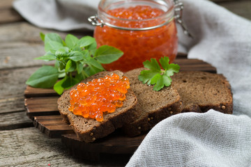 Red caviar in a glass jar