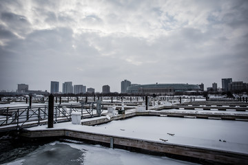 Several empty boat docks frozen in place