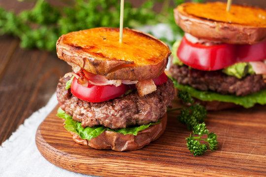 Homemade gluten free burger with sweet potato, beef, guacamole