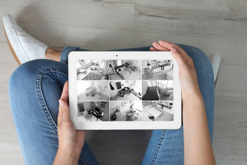 Woman holding tablet with blank screen indoors. Mockup for design
