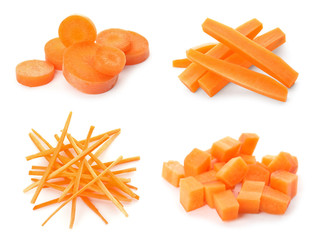 Set with ripe cut carrots on white background
