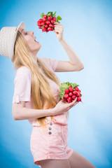 Young woman holding radish