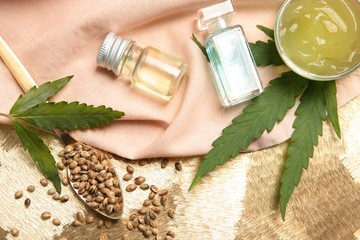 Flat lay composition with hemp lotion on color background