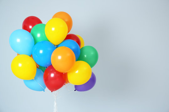 Bunch of bright balloons and space for text against white background