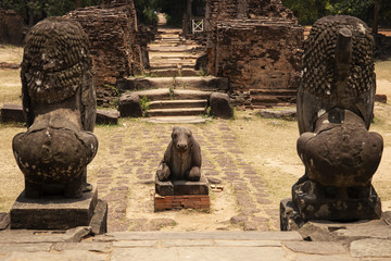Ancient temple stone monument in Angkor Wat complex, Cambodia. Nandi bull and lion statue. Hindu temple sculpture.