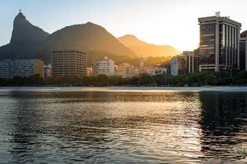Fototapete - Corcovado Mountain by Sunset View, with Buildings of Botafogo District, in Rio de Janeiro