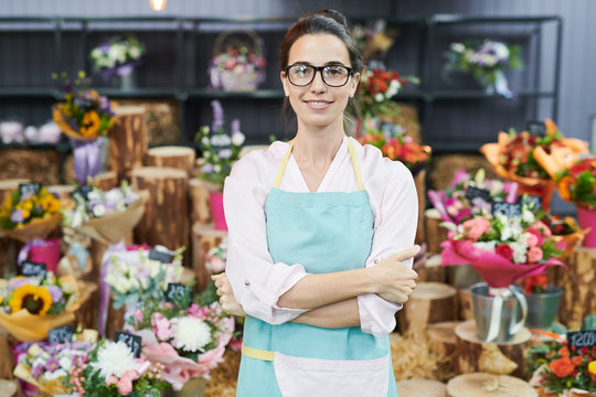 Portrait of female floser shop owner posing confidently and looking at camera