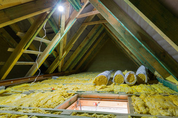 Empty attic in the house with mineral wool insulation