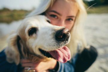 beautiful girl with pet retriever