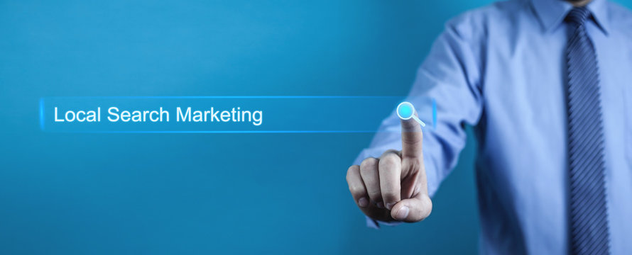 Businessman pressing Local Search Marketing button. Business concept