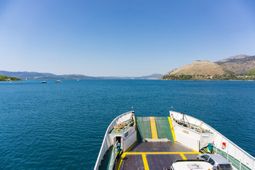 Top view of the bow of a ferry boat in the bay of Argostoli city sailing to Lixouri in Kefalonia Greece