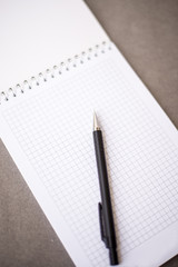 the notebook lies black pencil on the diagonal of the sheet