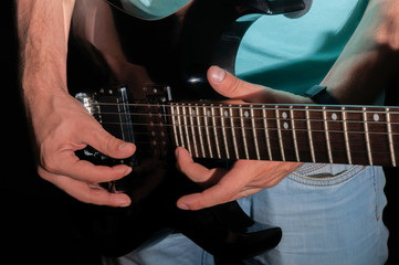 Man playing electric guitar, close-up