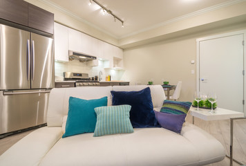 Bright living room with kitchen and dinner table. Interior design.