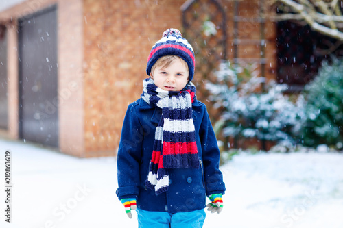 Cute little funny child in colorful winter fashion clothes having ... 772f834d2