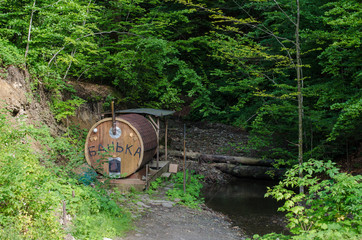 Outdoor recreation - sauna on a mountain river in Carpathian