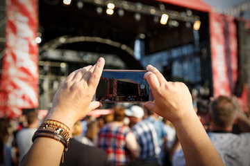Video recording of the concert on the mobile phone, smartphone in hands