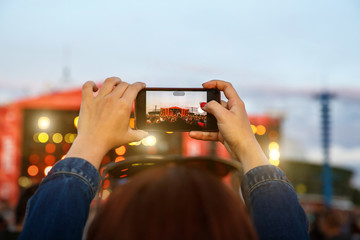 Close up of recording video with smartphone during a concert, Fingers on the screen