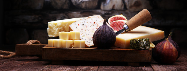 Cheese plate served with figs, various cheese on a platter