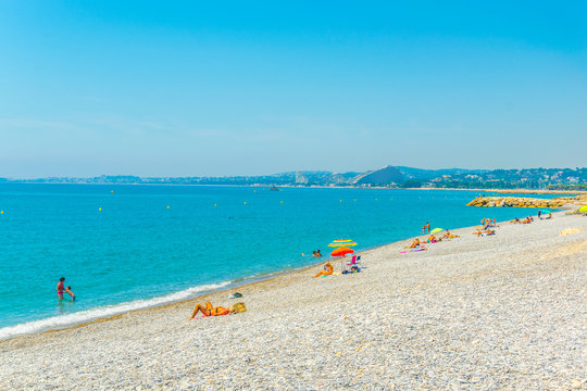 People are enjoying summer on a beach in Cagnes sur Mer, France
