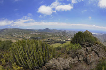 The panoramic views from the summit of Roque del Conde, towards the southern coast of the island, a table-top mountain, an arid landscape with scarce endemic flora, in Tenerife, Canary Islands, Spain