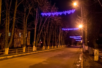Night city road decorated by illumination for Christmas and New Year holidays