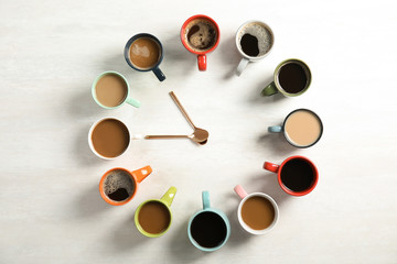 Flat lay composition with cups of coffee on light background. Food photography