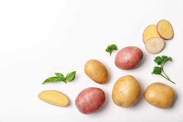 Flat lay composition with fresh organic potatoes and space for text on white background