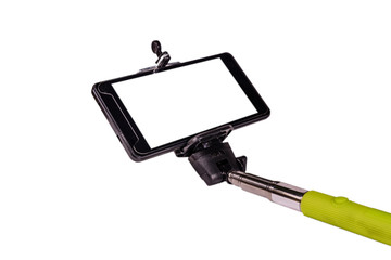 Selfie stick with modern smartphone isolated on a white background