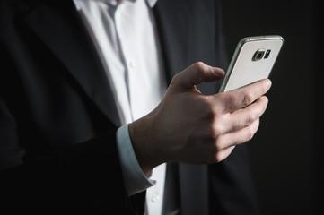 business phone smarphone jacket suit white shirt black hand man finance technology