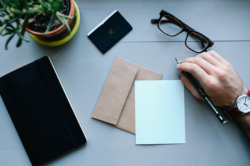 desk office work corporate business finance tablet letter hand man watch glasses letter paper pen plant