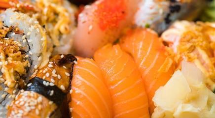 sushi maki raw fish asian food japanese salmon seaweed rice