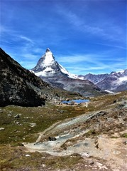Photo sur Aluminium Reflexion lake reflection Matterhorn sky swiss