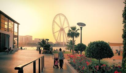 Dubai, UAE. Dubai Marina promenade at sunset. Ferris wheel, Dubai marina beach,.