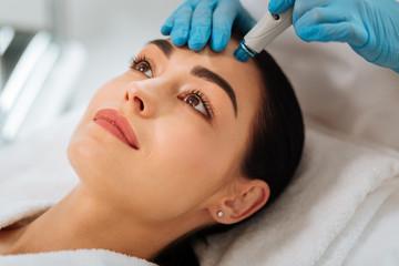 Hydrafacial procedure. Close up of a face of a nice beautiful woman during hydrafacial procedure