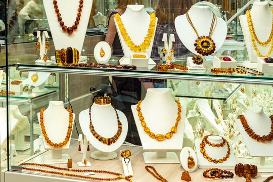 Window of amber shop. Amber jewelry (accessories).