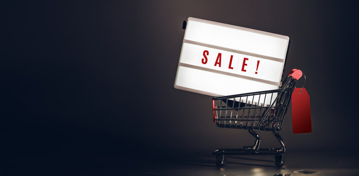 Sale light box in shopping cart with price tag at dark studio room banner size.Mock up header leave space for adding text or design for promote business campaign on line.