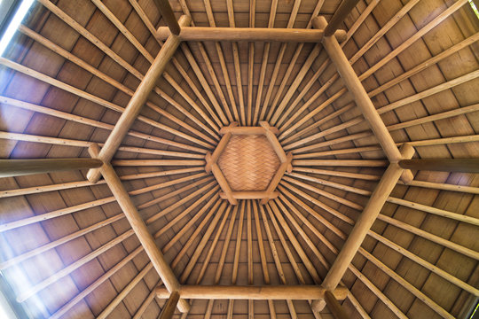 Hexagonal shape of a wicker and bamboo roof bottom of the gazebo roof located on the Mejiro Garden Lake.