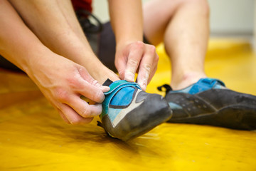 Photo of sporsman wearing athletic shoes in gym