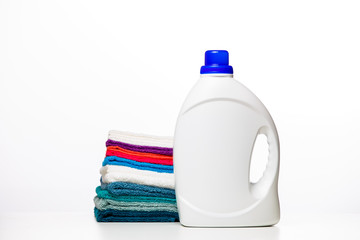 Photo of bottle of cleaning products and multi-colored cloths
