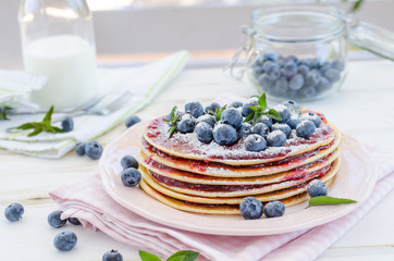 Vintage pancakes outside garden with blueberries