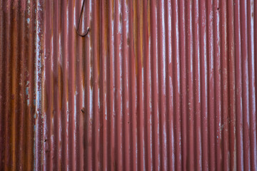 Old red corrugated iron wall