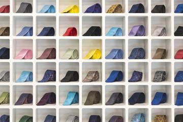 Neckties arranged in a grid shelf